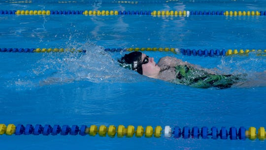 Northridge senior Riley Bunstine competes in the backstroke during a swim meet hosted by the Johnstown/Northridge Jaguars on Wednesday, June 26, 2019 at the Johnstown Skate N Swim.