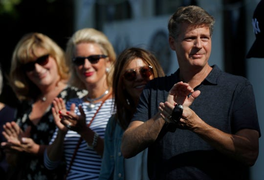 From right, Yankee controlling owner Hal Steinbrenner, his wife Christina DiTullio, Jessica Steinbrenner and Jennifer Steinbrenner Swindal during a private Baseball Clinic in London, Thursday, June 27, 2019. The Yankees are hosting for approximately 100 youth in the London community in conjunction with the London Meteorites Baseball and Softball Club this private Baseball Clinic. (AP Photo/Frank Augstein)
