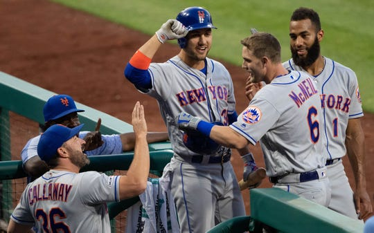 New York Mets second baseman Jeff McNeil (6) is congratulated by teammates after hitting a home run during the fifth inning against the Philadelphia Phillies at Citizens Bank Park.