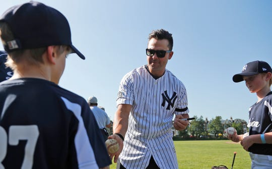 Yankees' Greg Bird plays with young fans during a private Baseball Clinic in London, Thursday, June 27, 2019. The Yankees are hosting for approximately 100 youth in the London community in conjunction with the London Meteorites Baseball and Softball Club this private Baseball Clinic. (AP Photo/Frank Augstein)