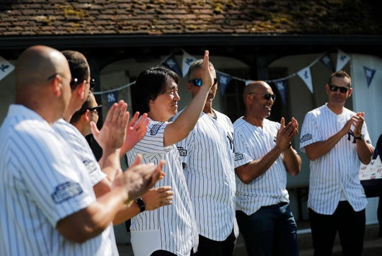 Hideki Matsui waves as other players applaud before the start of a private Baseball Clinic in London, Thursday, June 27, 2019. The Yankees are hosting for approximately 100 youth in the London community in conjunction with the London Meteorites Baseball and Softball Club this private Baseball Clinic.