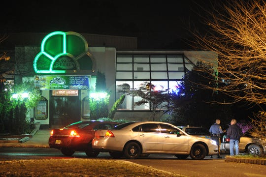 Before its run as Hibachi Buffet, the building was home to Casey O'Toole's Tavern, pictured after a shooting Nov. 1, 2011.