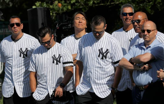 Yankee players listen before the start of a private Baseball Clinic in London, Thursday, June 27, 2019. The Yankees are hosting for approximately 100 youth in the London community in conjunction with the London Meteorites Baseball and Softball Club this private Baseball Clinic. (AP Photo/Frank Augstein)