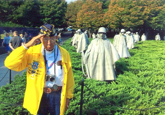 Airman Ruben Acosta saluted at the Korean War Memorial in Washington DC during his Honor Flight trip last year. Acosta will lead the city's Fourth of July parade as grand marshal.