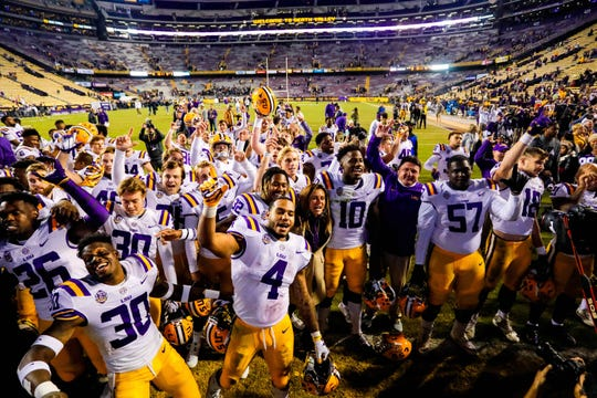 Nov 17, 2018; Baton Rouge, LA, USA;  LSU Tigers running back Nick Brossette (4) and head coach Ed Orgeron celebrates a victory over Rice Owls by a score of 42-10 at Tiger Stadium. Mandatory Credit: Stephen Lew-USA TODAY Sports
