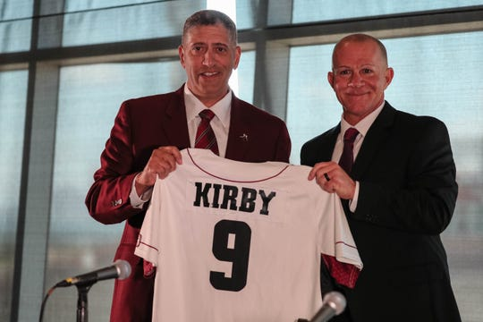 Mario Moccia and Mike Kirby pose for photos at a press conference held in Fulton Center at New Mexico State University introducing Kirby as the new head baseball coach for NMSU on Thursday, June 27, 2019.