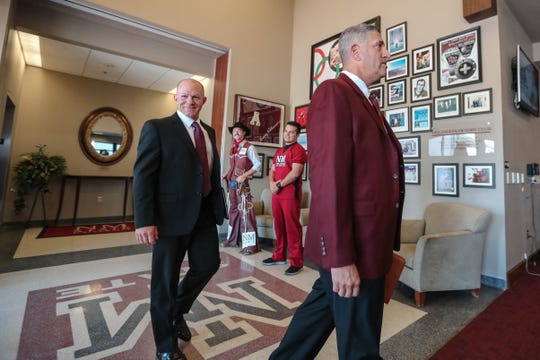 Mario Moccia and Mike Kirby enter the press conference held in Fulton Center at New Mexico State University introducing Kirby as the new head baseball coach for NMSU on Thursday, June 27, 2019.