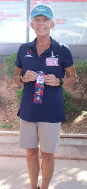 Betty Burgess holds the 6th place ribbon which she won in the 1,500-meter race walk at the National Senior Games in Albuquerque earlier this month.