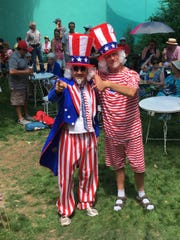 Raul Turrietta, left, poses in the Silver City Museum courtyard with fellow museum volunteer John Warner. Turrietta will again emcee the museum's Ice Cream Social on July 4.
