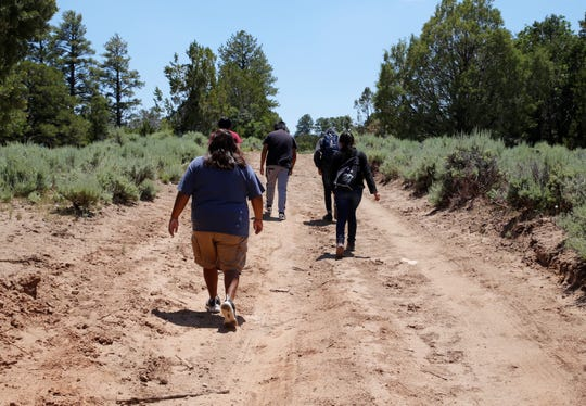 Members of the summer youth employment program for Tooh Haltsooí Chapter hike on June 25 on Ch'ooshgai Mountain in Sheep Springs.