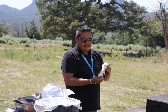 Tooh Haltsooí Chapter Manager Kevin Begay helps coordinate the summer program with volunteers and members of the Along the Ch'ooshgai Mountain Group.