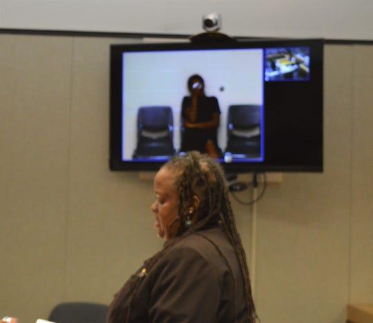 Steffani Jones, 26, sobs on the video screen while her attorney, Regina Jemison, speaks on her behalf during a Thursday, June 27, 2019, arraignment.