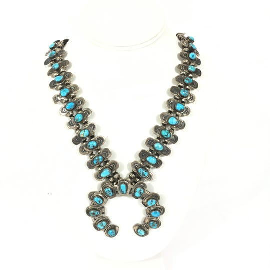 Traditional squash blossom necklace in silver and turquoise with naja.