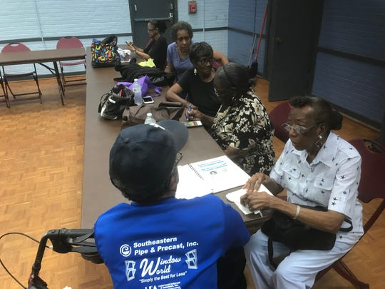Clients of the Council on Aging's senior lunch program talk Thursday at the Fricker Resource Center. Many of the clients said they are concerned they could lose access to health care services when Baptist Hospital moves to a new facility on Brent Lane.