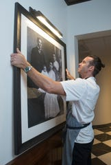 Executive chef James Briscione shows where a photo of Pensacola entrepreneur Angelena Giardina and her family will hang at the new Angelena's Ristorante Italiano in downtown Pensacola on Thursday.