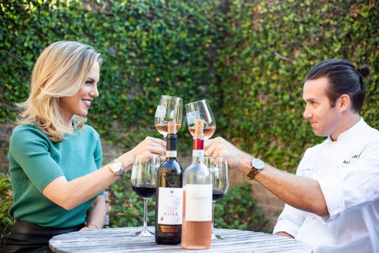 Brooke Parkhurst, director of wine and marketing at Angelena's, enjoys a glass of wine with James Briscione, her husband and the new restaurant's executive chef. Angelena's Ristorante Italiano opens Monday to the public.