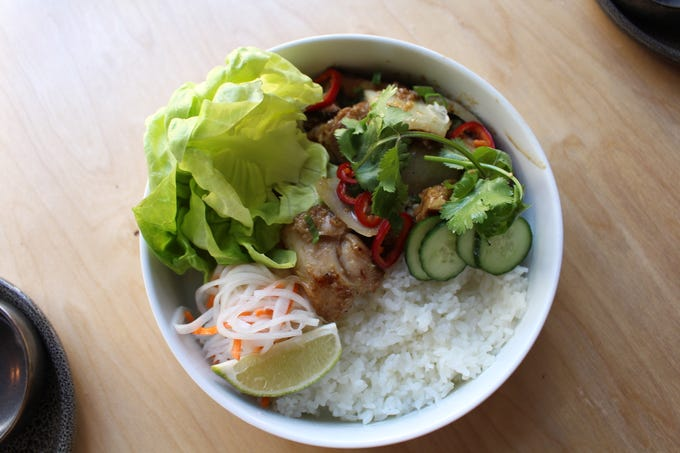 The lemongrass chicken wok dish from Obon Sushi + Bar + Ramen. Chef Paulo Im prepared the dish.