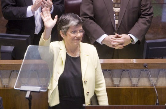 Gov. Janet Napolitano waves to the chamber after the State of the State at the Capitol Monday, Jan. 9, 2006.