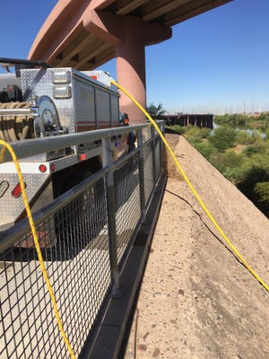 Fire crews work on a brush fire that started Thursday below the Loop 101 and Loop 202 interchange in Tempe.