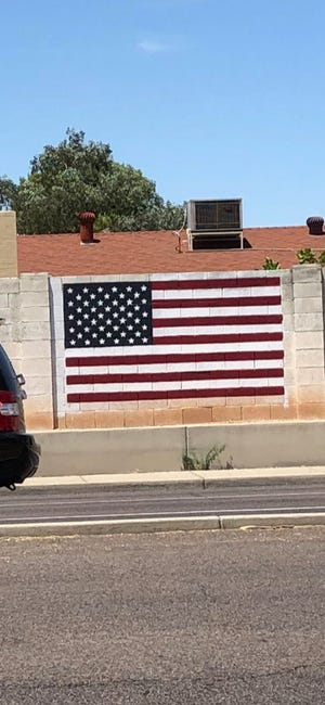 The flag, pictured the week before it was vandalized, had recently been repainted, Giacoppo said.