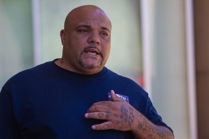 Roland Harris, father of Jacob Harris who was fatally shot by Phoenix Police Department officers in January, motions to his heart while describing information he received from a secondary coroner's report during a press conference where he demanded the release of body cam footage on June 26, 2019, outside Phoenix City Hall.