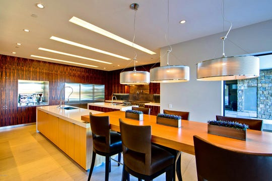 The $7.4 million Paradise Valley mansion, sold by Fabrice and Misty-Anne Dechoux, features a modern kitchen with a custom chef's table.