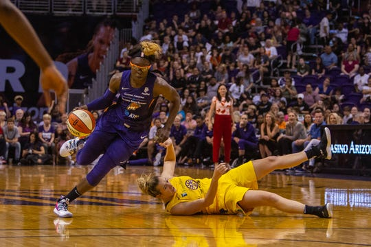 Mercury guard Essence Carson drives to the basket during a game against the Sparks on June 23 at Talking Stick Resort Arena.