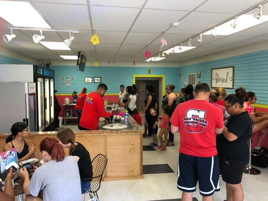 A long line forms at Zala's Rolled Ice Cream in Lebanon as some customers will wait up to an hour for their frozen treats.