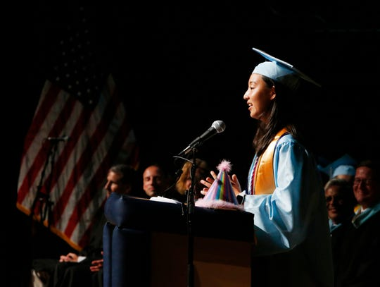 Valedictorian Amy Zhou speaks during the John Jay High School graduation at the Majed J. Nesheiwat Convention Center on June 26, 2019. Zhou celebrated her birthday with her classmates during the ceremony.