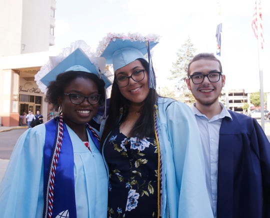 From left, Chelsea Commodore, Ahlam Salameh and Travis Stillwell prior to the start of the John Jay High School graduation on June 26, 2019.