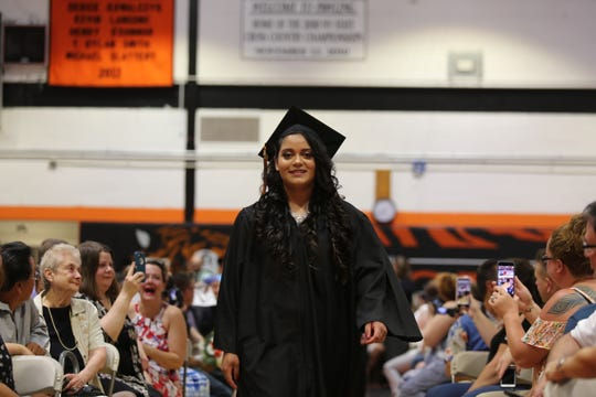 Camila Palma walks through the crowd before getting her diploma on Wednesday night.