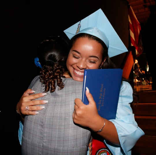 Siena Ferreira gives a hug to school counselor Michele Wells during the John Jay High School graduation at the Majed J. Nesheiwat Convention Center on June 26, 2019.