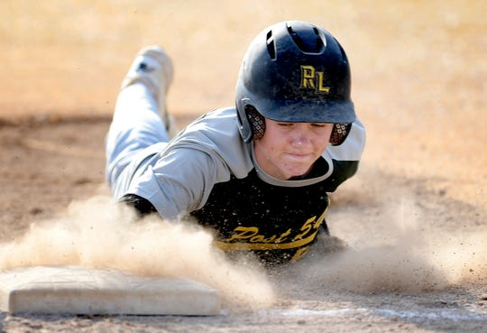 Red Lion's Ryan Stabley dives back to first earlier this season in York-Adams American Legion baseball action. Red Lion opens the league playoffs Tuesday at unbeaten New Oxford.