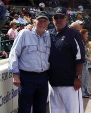 Brooks Robinson, left, and Andy Etchebarren are shown during Etchebarren's final game as York Revolution manager on Sept. 16, 2012.