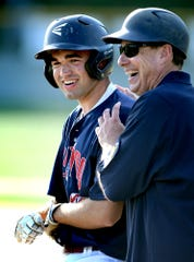 Pleasureville's coach Joe Reed jokes with Nathan Marquard after the catcher advanced to first during American Legion baseball at Red Lion Wednesday, June 26, 2019. Bill Kalina photo