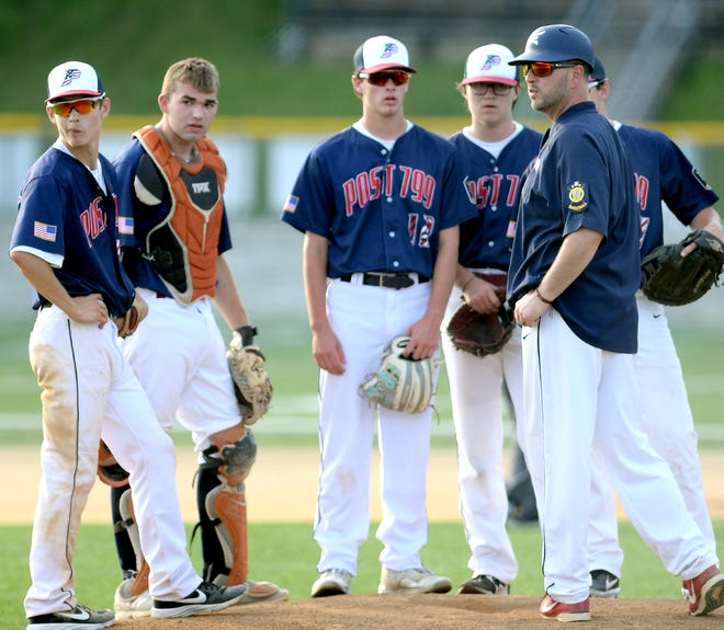 Pleasureville manager Elliot Ness, right, talks to his team during a mid-inning conference at Red Lion Wednesday, June 26, 2019. Bill Kalina photo