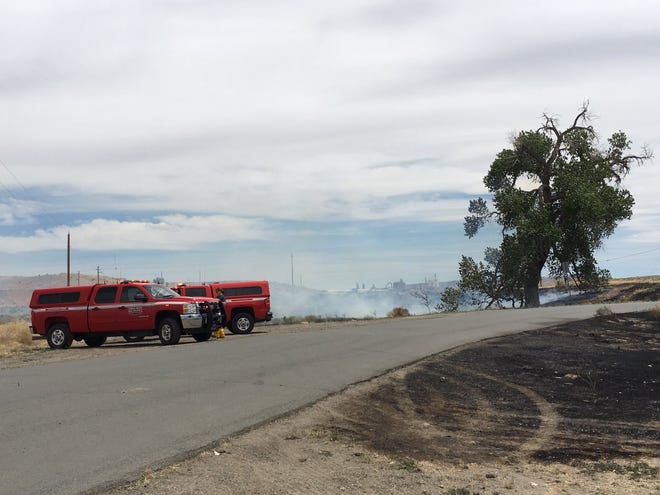 Truckee Meadows Fire Protection District vehicles are seen in front of a fire near Wadsworth on June27, 2019. The fire broke out on the region's first red flag day of the year.