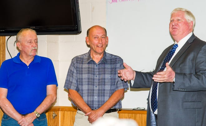 Yerington mayor-elect John Garry (right) thanks outgoing City Council member Larry Reynolds (left) and Mayor George Dini during a luncheon honoring them Monday following their last council session.