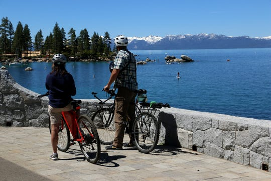 The Tahoe Fund's Amy Berry and the RGJ's Ben Spillman enjoy the view of Sand Harbor while taking a ride on the new Tahoe East Shore Trail on June 25, 2019.