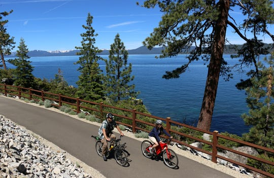 The Tahoe Fund's Amy Berry and the RGJ's Ben Spillman take a ride on the new Tahoe East Shore Trail on June 25, 2019.
