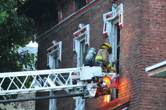 After attic fire, North 11th Street building must come down