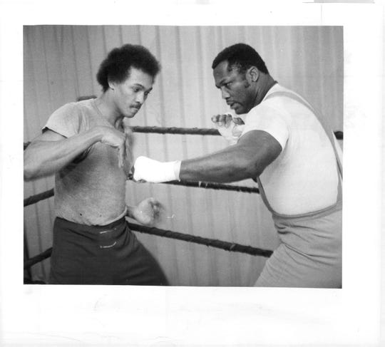 "Willie ""The Worm'' Monroe training with heavyweight champ Joe Frazier at City Recreation Center, 999 South Avenue. Monroe fought twice in Rochester in mid-1970s in preparation for rematches with Marvin Hagler. His appearances sparked revival in boxing in Rochester. Monroe fought on the undercard of many of Smokin' Joe's biggest fights."