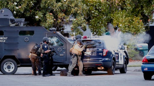 A SWAT team fires tear gas into a Redding home during a seven-hour standoff with a Redding man.