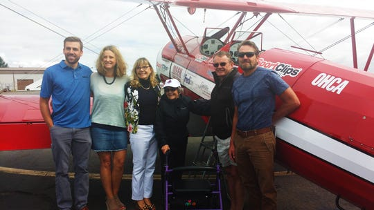 Family members pose with Chris Schiess after her flight provided by the Ageless Aviation Dreams Foundation.
