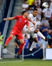 United States' Daniel Lovitz (16) and Panama' Francisco Palacios (2) go up for the ball during the first half of a CONCACAF Gold Cup soccer match in Kansas City, Kan., Wednesday, June 26, 2019.