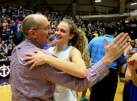 South Salem coach Nick McWilliams and daughter Katie celebrate their 2015 state championship against St. Mary's at the University of Portland.