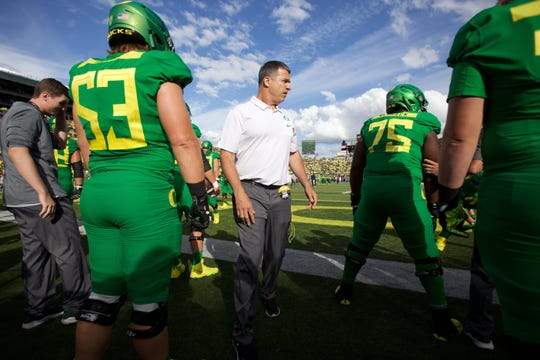 Sep 22, 2018; Eugene, OR, USA;  Oregon Ducks head coach Mario Cristobal coaches during warm-ups before the Ducks take on the Stanford Cardinal at Autzen Stadium. Mandatory Credit: Jaime Valdez-USA TODAY Sports