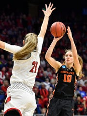 Oregon State guard Katie McWilliams (10) shoots against Louisville forward Kylee Shook (21) during the Lexington regional on Mar 25, 2018.