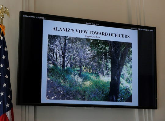 This slide, from the DA's office, shows the vantage point of Kevin Anthony Alaniz, 26, of Milipitas, during the fatal officer-involved shooting Saturday in Big Sur, Calif. The two yellow circles represent the location of the two park rangers, who shot and killed him.