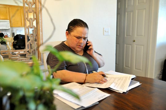 On June 10, 2019, Veronica Castro reviews medical paperwork at her Salinas home a couple months after she received ECMO treatment. which saved her life.